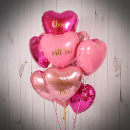 One Dozen Inflated Shades of Pink Heart Foil Balloons